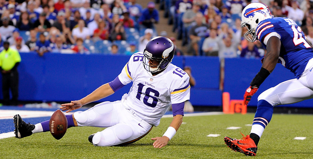 . Minnesota Vikings quarterback Matt Cassel (16) attempts to recover the ball he fumbled as Buffalo Bills\' Bryan Scott (43) chases him during the first half of an NFL preseason football game Friday, Aug. 16, 2013, in Orchard Park, N.Y. Buffalo Bills\' Jamie Blatnick recovered the ball in the end zone for a touchdown (AP Photo/Gary Wiepert)