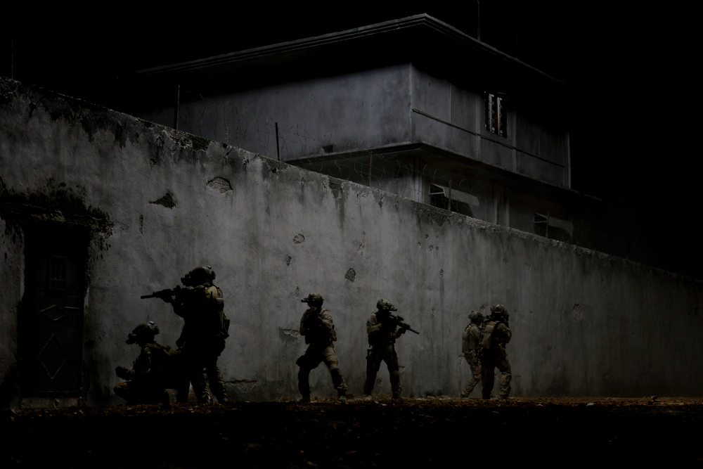 Description of . In the darkest hour of the night, elite Navy SEALs raid Osama Bin Laden's compound in