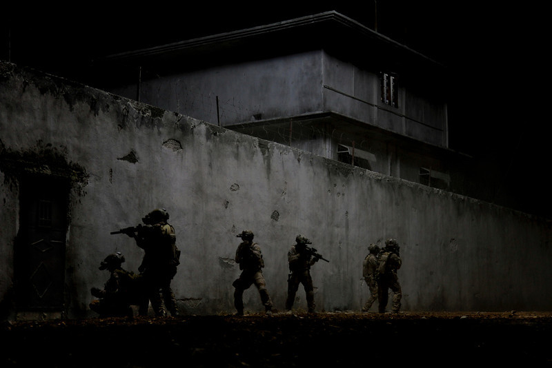 ". In the darkest hour of the night, elite Navy SEALs raid Osama Bin Laden\'s compound in ""Zero Dark Thirty.\"" Provided by Columbia Pictures."