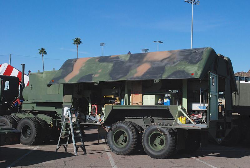 AM General 1984 915A1 5T w Southwest Mobile shop trailer rr lf 3-4.JPG