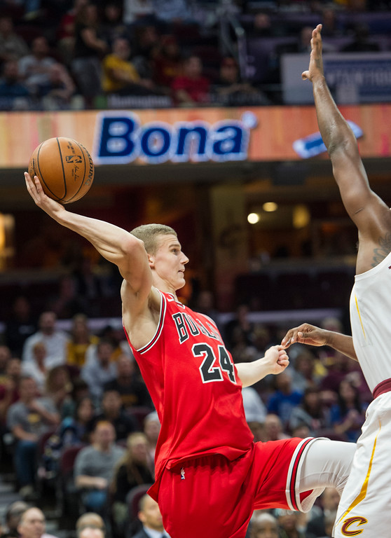 . Chicago Bulls\' Lauri Markkanen (24) saves a ball headed out of bounds against the Cleveland Cavaliers during the second half of an NBA preseason basketball game in Cleveland, Tuesday, Oct. 10, 2017. The Bulls won 108-94. (AP Photo/Phil Long)