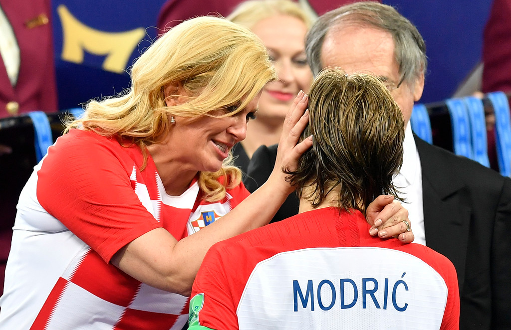 . Croatian President Kolinda Grabar-Kitarovic hugs Croatia\'s Luka Modric after France won the final match between France and Croatia at the 2018 soccer World Cup in the Luzhniki Stadium in Moscow, Russia, Sunday, July 15, 2018. (AP Photo/Martin Meissner)