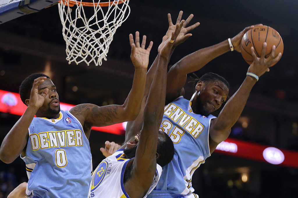 . Denver Nuggets\' Kenneth Faried, right, rebounds the ball over Golden State Warriors\' Draymond Green (23) during the first half of an NBA basketball game Thursday, April 10, 2014, in Oakland, Calif. At left is Nuggets\' Aaron Brooks. (AP Photo/Ben Margot)