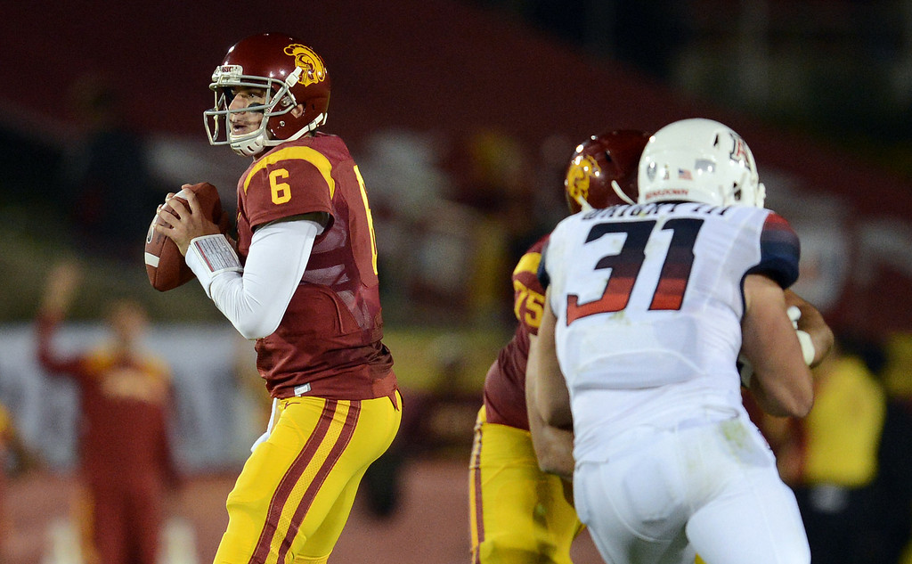 . \\USC quarterback Cody Kessler #6 looks to pass during their game against Arizona at the Los Angeles Memorial Coliseum Thursday, October 10, 2013. (Photo by Hans Gutknecht/Los Angeles Daily News)