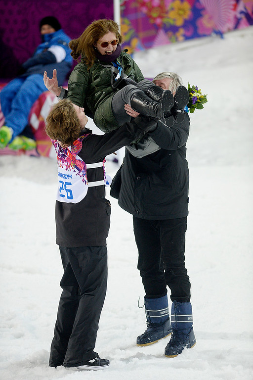 . Gold medalist Iouri Podladchikov of Switzerland and his father Yurii toss his mother Valentina in the air after the men\'s snowboard halfpipe final. Podladchikov knocked off two-time defending gold medalist Shaun White as the event\'s top placer. Sochi 2014 Winter Olympics on Tuesday, February 11, 2014. (Photo by AAron Ontiveroz/The Denver Post)