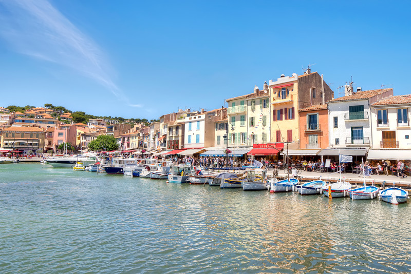 cassis-water-front-harbour-fishing-boats-blue-sky-rippling-water.jpg
