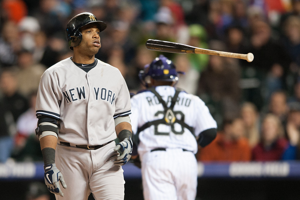 . Robinson Cano #24 of the New York Yankees flips his bat after striking out to end the eighth inning of a game against the Colorado Rockies at Coors Field on May 8, 2013 in Denver, Colorado. The Yankees beat the Rockies 3-2. (Photo by Dustin Bradford/Getty Images)