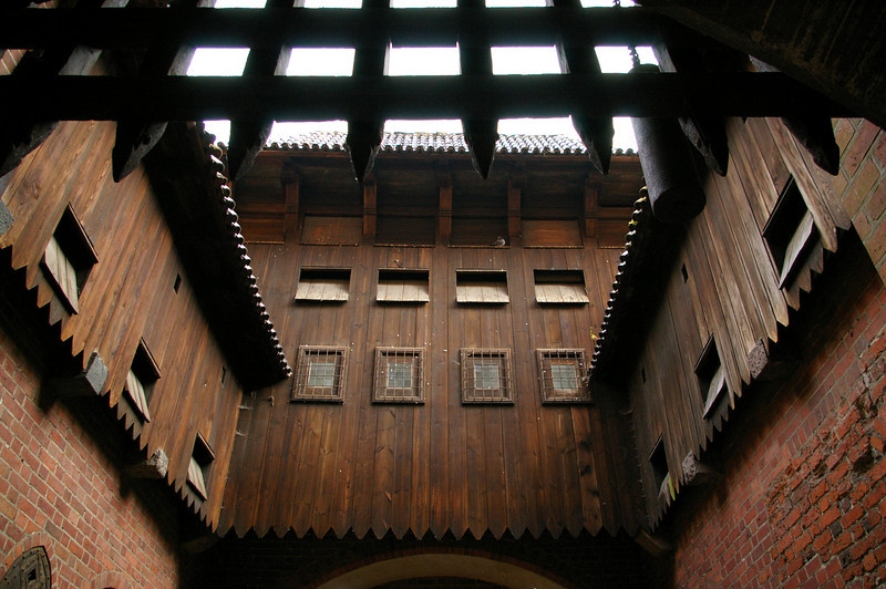 Founded in the 13th century by the Teutonic Knights, Malbork is noted for its Gothic castle, one of the most striking in Europe. Here the main gate of the castle.