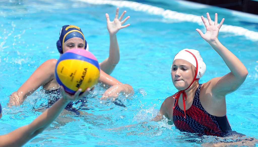 . Conquerors of Hacienda Heights, left, vs. North Allegheny team from Pennsylvania during the USA Water Polo Junior Olympics at Splash! La Mirada Regional Aquatics Center on Thursday, Aug. 1, 2013 in La Mirada, Calif. 