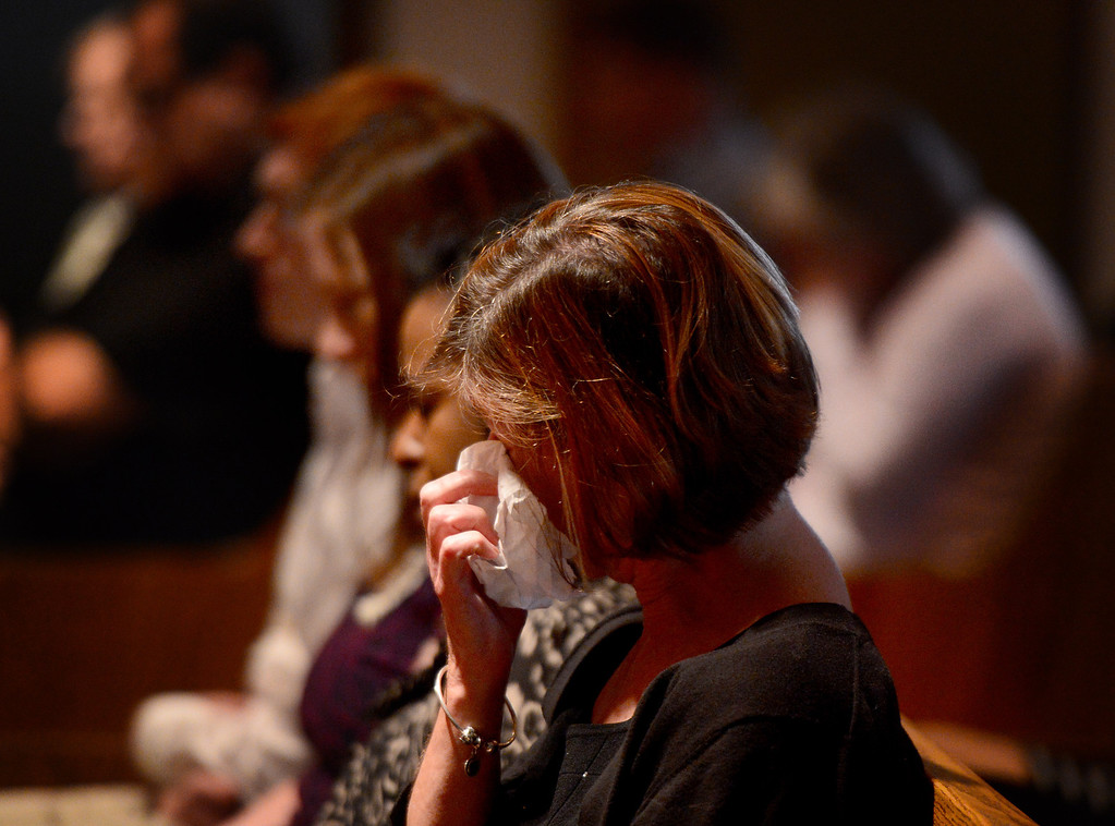 . A woman wipes her eyes during a memorial for April Jace at Biola University\'s Calvary Chapel Tuesday, May 20, 2014 after Los Angeles Police said they arrested actor Michael Jace on suspicion that he shot and killed his wife. April was a financial aid counselor at the La Mirada college. (Photo by Sarah Reingewirtz/Pasadena Star-News)