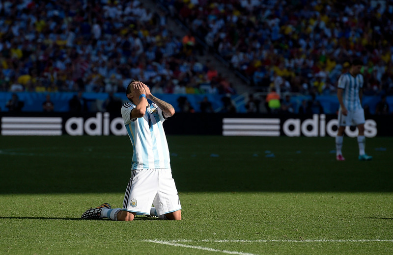 . Argentina\'s Angel di Maria reacts after missing a near goal during the World Cup round of 16 soccer match between Argentina and Switzerland at the Itaquerao Stadium in Sao Paulo, Brazil, Tuesday, July 1, 2014. (AP Photo/Manu Fernandez)