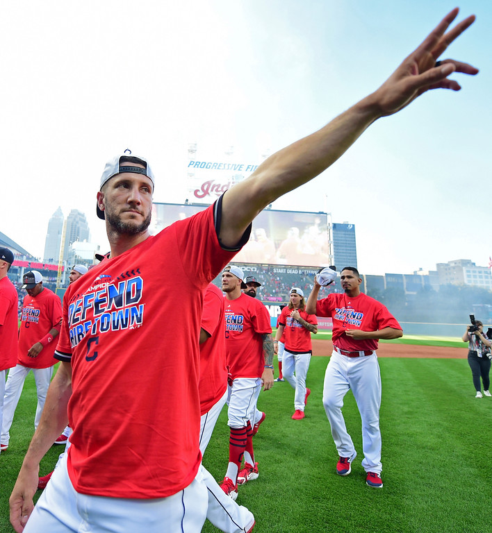 . Cleveland Indians\' Yan Gomes waves to fans after the Indians defeated the Detroit Tigers 15-0 to clinch the American League Central Division, in a baseball game, Saturday, Sept.15, 2018, in Cleveland. (AP Photo/David Dermer)