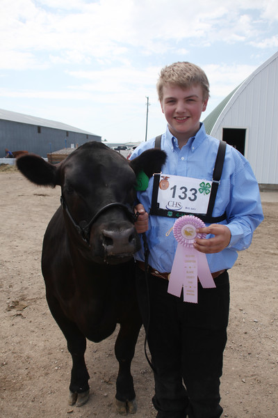 Havre Daily News / Floyd Brandt  Cody Arnold 4H / FFA Senior Beef Showing Blain County Fair Saturday, with Tank