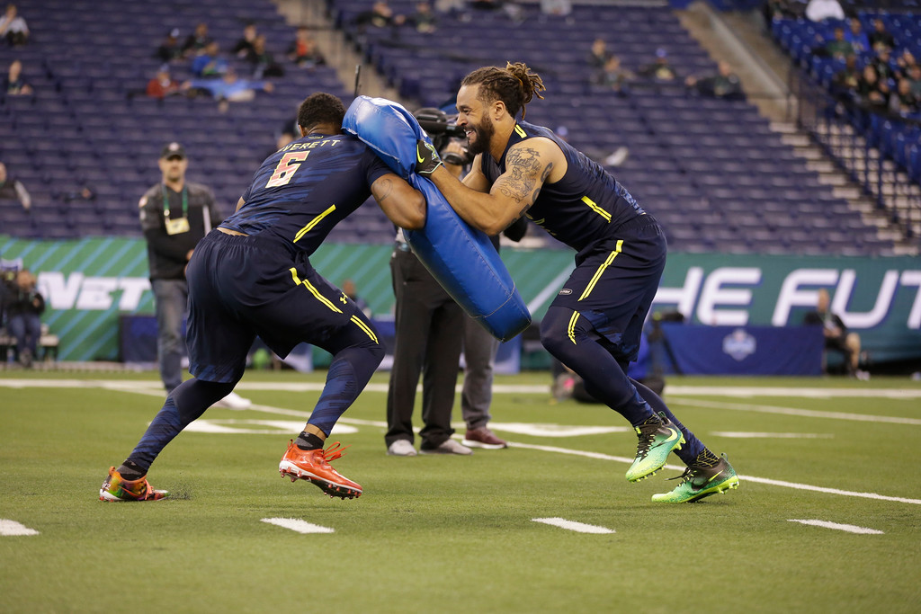 . Virginia Tech tight end Bucky Hodges, right, blocks South Alabama tight end Gerald Everett runs a drill at the NFL football scouting combine in Indianapolis, Saturday, March 4, 2017. (AP Photo/Michael Conroy)