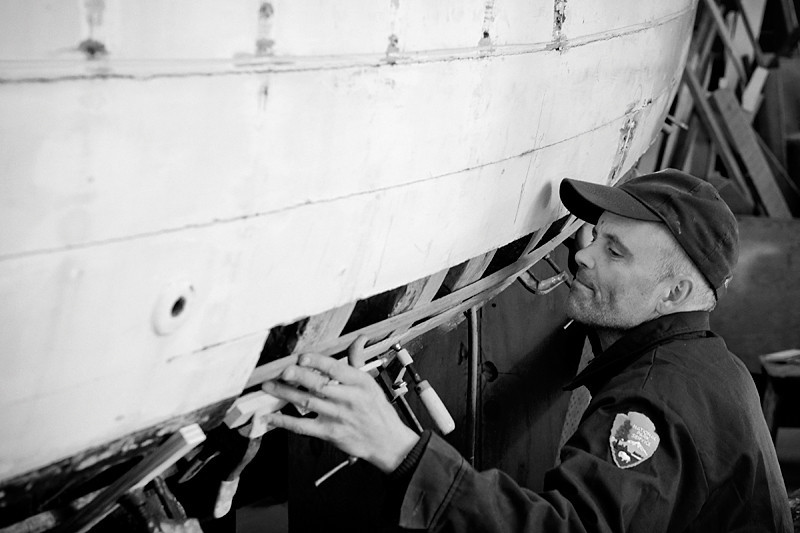 Restoration  NPS employee restoring a historical boat.