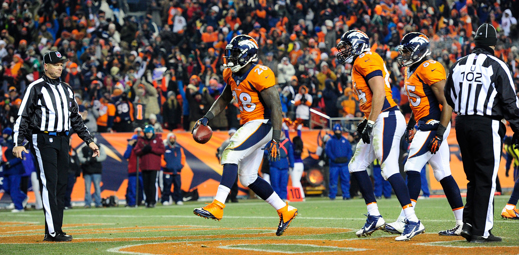 . Denver Broncos running back Montee Ball (28) scores a touchdown in the fourth quarter. The Denver Broncos take on the Tennessee Titans at Sports Authority Field at Mile High in Denver on December 8, 2013. (Photo by AAron Ontiveroz/The Denver Post)