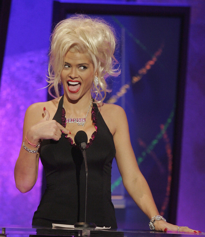 . ** FILE ** Anna Nicole Smith introduces Kanye West during the 32nd annual American Music Awards in this Nov. 14, 2004,file photo at the Shrine Auditorium in Los Angeles. Smith, 39, the former Playboy playmate whose bizarre life careened from marrying an octogenarian billionaire to the untimely death of her son, died Thursday, Feb. 8, 2007, after collapsing at a South Florida hotel, one of her lawyers said. (AP Photo/Mark J. Terrill, file)