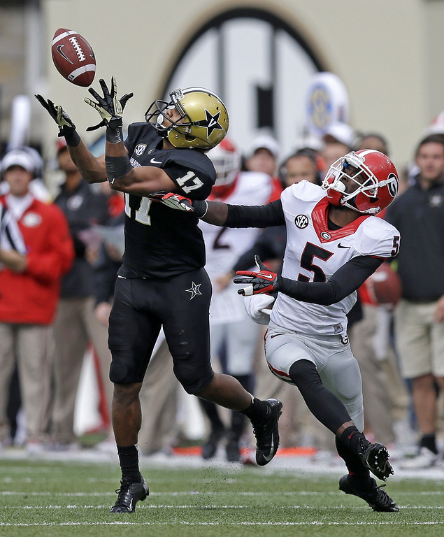 . Vanderbilt wide receiver Jonathan Krause (17) catches a pass for a 41-yard gain as he is defended by Georgia cornerback Damian Swann (5) in the fourth quarter of an NCAA college football game on Saturday, Oct. 19, 2013, in Nashville, Tenn. Vanderbilt upset No. 15 Georgia 31-27. (AP Photo/Mark Humphrey)