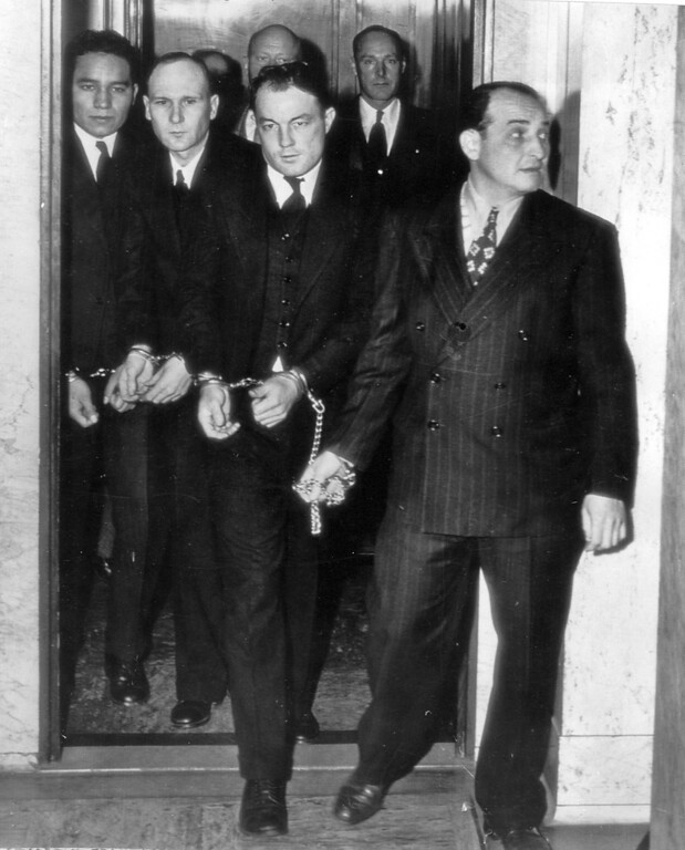 . Shackled together , from left, Clarence Carnes, Sam Shockley, and Miran Thompson are led from an elevator in the federal building and taken to court by a U.S. Marshal for arraignment on a murder charge stemming from an abortive prison break at Alcatraz Federal Penitentiary in May 1946. (AP Photo/Tribune archives)