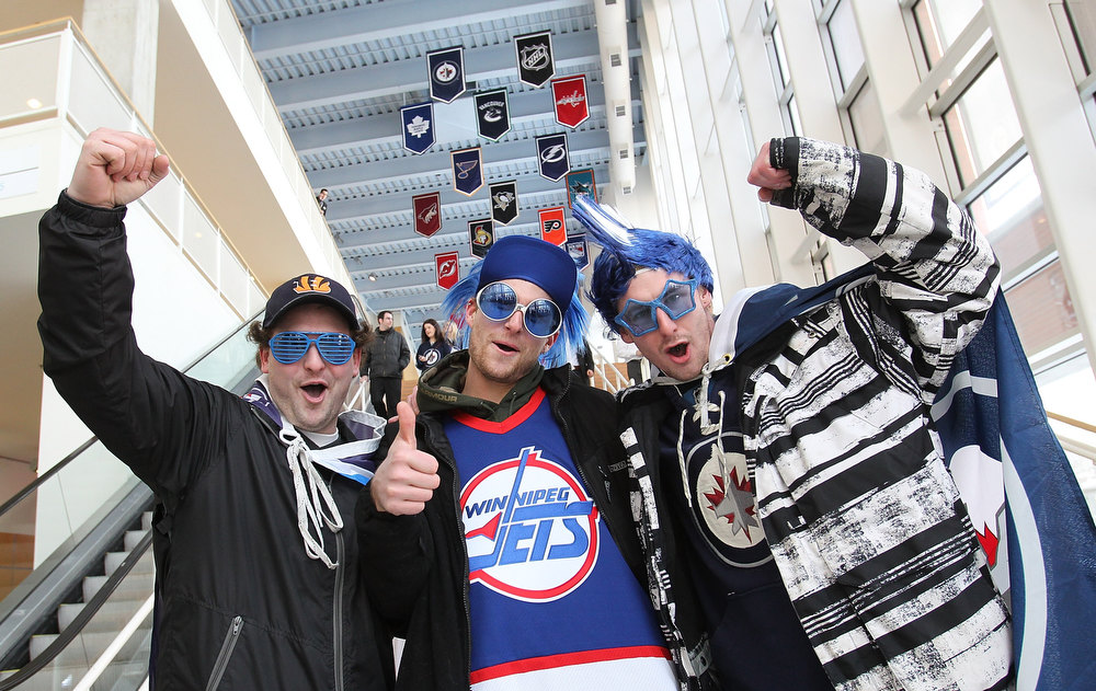 Description of . WINNIPEG, MB - JANUARY 19:  Fans (L-R) Derek McMahon, Lucas Stout, and Darryl Chartrand cheer for the cameras as they make their way to the doors before the Winnipeg Jets and Ottawa Senators game on January 19, 2013 at the MTS Centre in Winnipeg, Manitoba, Canada. (Photo by Marianne Helm/Getty Images)