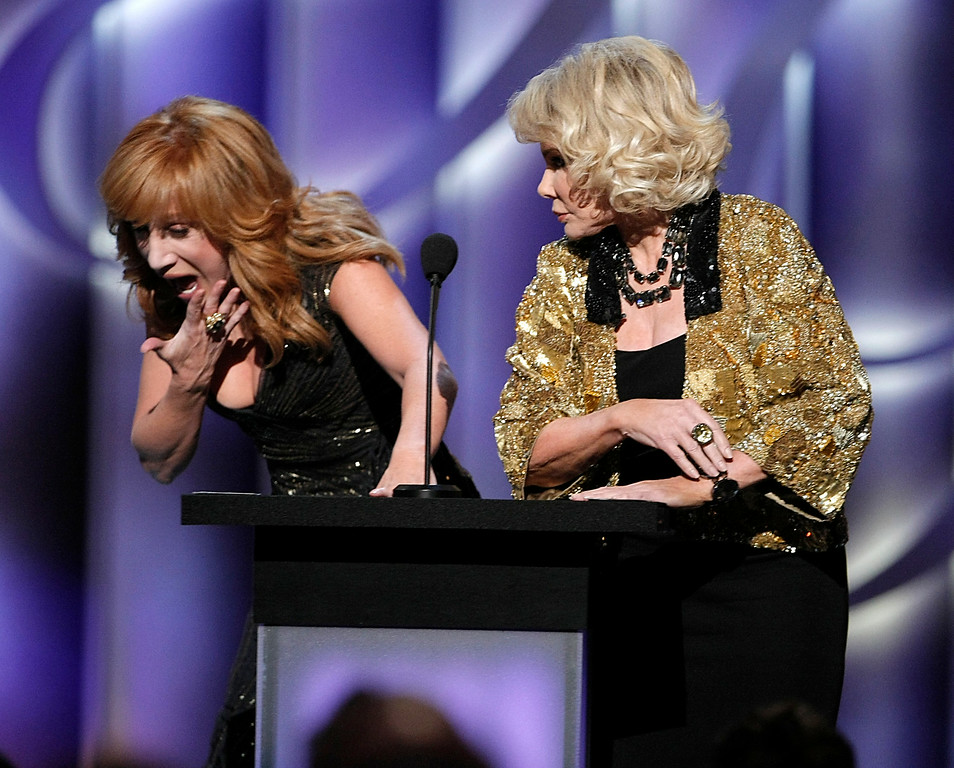 """. Comedienne and roast master Kathy Griffin, left, winces as comedienne and roastee Joan Rivers pretends to slap her face at the \""""Comedy Central Roast of Joan Rivers\"""" in Los Angeles on Sunday, July 26,  2009. (AP Photo/Dan Steinberg)"""