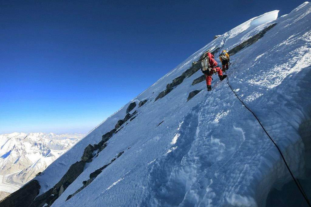 . Climbers make their way to the summit of Mount Everest, in the Khumbu region of the Nepal Himalayas on May 18, 2013. Nepal celebrated the 60th anniversary of the conquest of Mount Everest on Wednesday, May 29, 2013, by honoring climbers who followed in the footsteps of Edmund Hillary and Tenzing Norgay. (AP Photo/Alpenglow Expeditions, Adrian Ballinger)