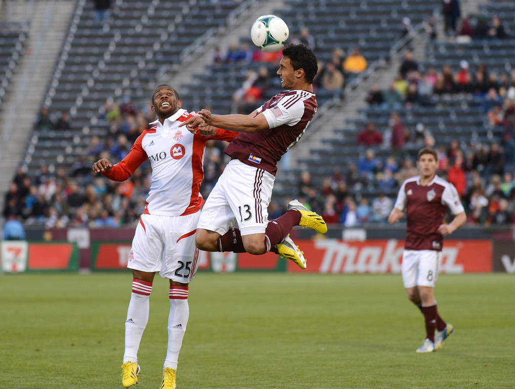 . COMMERCE CITY, CO. - MAY 04 : Kamani Hill #13 of Colorado Rapids heads the ball over Jeremy Hall #25 of Toronto FC during the 1st half of the game at Dick\'s Sporting Goods Park in Commerce City, Colorado. May 4, 2013. (Photo By Hyoung Chang/The Denver Post)