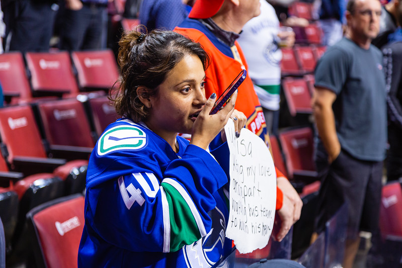 A Canuck fan excitedly talks into her phone while watching  the pregame warmup skate at the BB&T Center on Thursday, January 9, 2020, where the Florida Panther hosted the Vancouver Canucks. The Panthers would go on to beat the Canucks 5-2.  [JOSEPH FORZANO/palmbeachpost.com]
