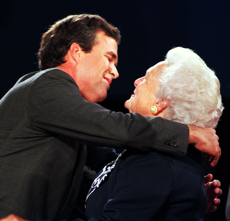 . Former first lady Barbara Bush, right, hugs her son Jeb after his debate with Democratic gubernatorial challenger Buddy MacKay on Tuesday night, Oct. 20, 1998, in St. Petersburg, Fla. (AP Photo/Steve Nesius, Pool)