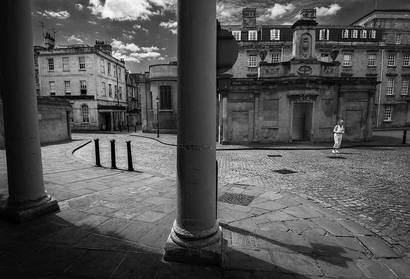 A single woman in the old city of Bath.  Bath, England, 2018