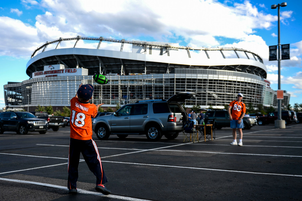 . DENVER, CO - AUGUST 23:  Alex Kubacki tosses a football with his father Michael Kubacki before the start of the a preseason football game between the Denver Broncos and the Houston Texans at Sports Authority Field at Mile High on Saturday, August 23, 2014 in Denver, Colorado.  (Photo by Kent Nishimura/The Denver Post)