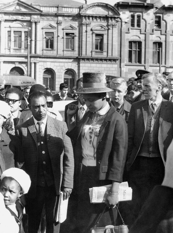 . Winnie Mandela (C), leaves the Palace of Justice in Pretoria 16 June 1964 with her fist clenched, after the verdict of the Rivonia Trial was given, sentencing eight men, including her husband anti-apartheid leader and African National Congress (ANC) member Nelson Mandela, to life imprisonment. The men were charged with conspiracy, sabotage and treason. (Photo credit should read OFF/AFP/Getty Images)