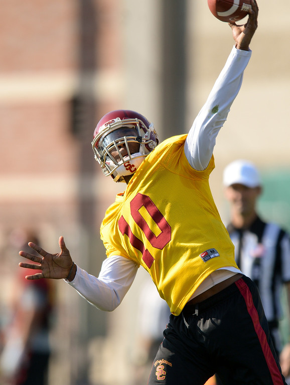 . USC QB Jalen Greene throws deep at practice, Thursday, March 27, 2014, at USC. (Photo by Michael Owen Baker/L.A. Daily News)
