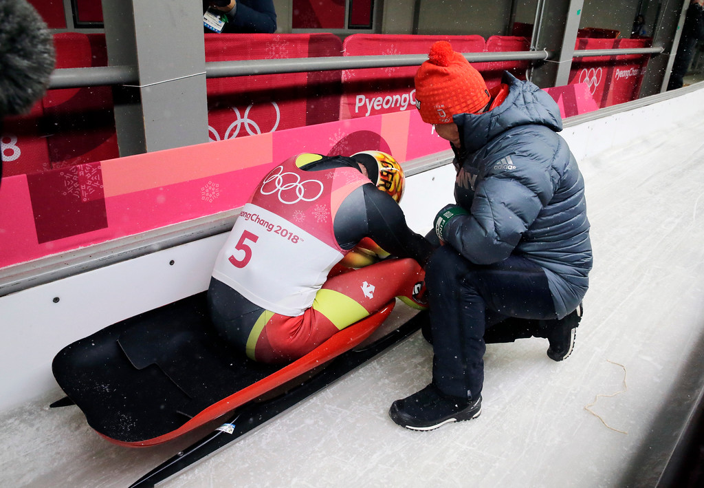 . Felix Loch of Germany sits dejected in the finish area after losing his lead on the final run during the men\'s luge competition at the 2018 Winter Olympics in Pyeongchang, South Korea, Sunday, Feb. 11, 2018.(AP Photo/Andy Wong)