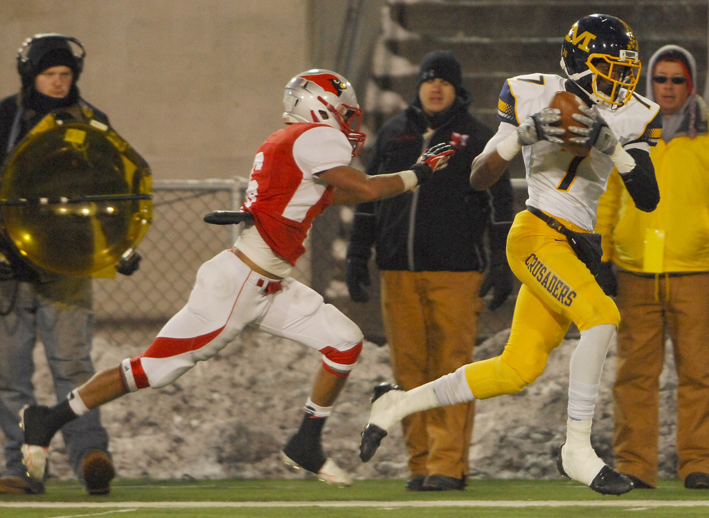 . Michael Allen Blair/ MBlair@News-Herald.com Cincinnati Moeller wide receiver Isaiah Gentry hauls in a long pass behind the defense by Mentor\'s Kiyah Powell setting up what turned out to be the winning touchdown during Saturday\'s Div. I state championship game at Fawcett Stadium in Canton.