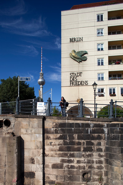 Sign of the former GDR on a building by the Spree river, Nikolaiviertel, Berlin, Germany