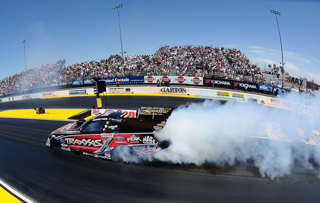 . Eventual Funny Car winner does her burnout during the quarterfinal round at the 27th annual NHRA Sonoma Nationals Sunday July 27, 2014. Courtney defeated her father John Force in the final round. Khalid alBalooshi (Top Fuel), Courtney Force (Funny Car), Jason Line (Pro Stock) and Eddie Krawiec (Pro Stock Motorcycle) all won event titles in their respective classes Sunday July 27, 2014 at the 27th annual NHRA Sonoma Nationals. (Will Lester/Staff Photographer)