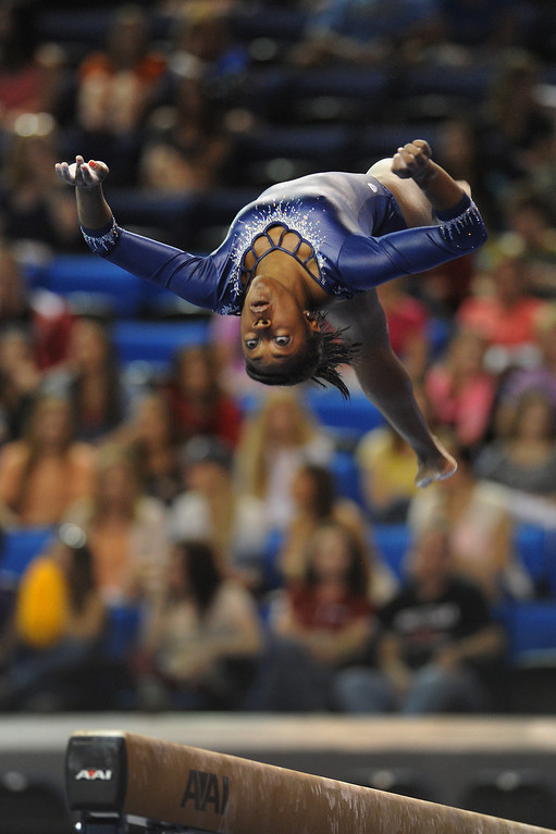 . UCLA\'s Olivia Courtney performs on the balance beam at the NCAA Women\'s Gymnastics Championship Team Finals at Pauley Pavilion, Saturday, April 20, 2013. (Michael Owen Baker/Staff Photographer)
