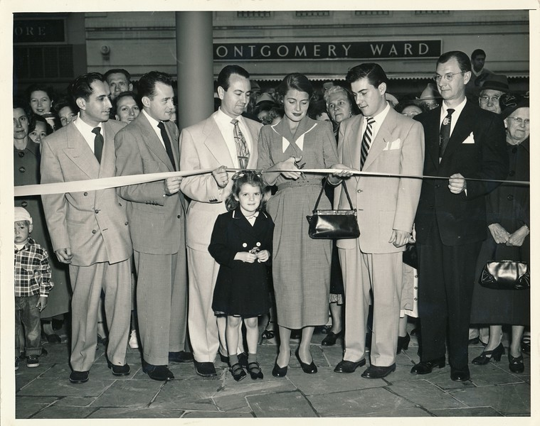Lester to left of woman