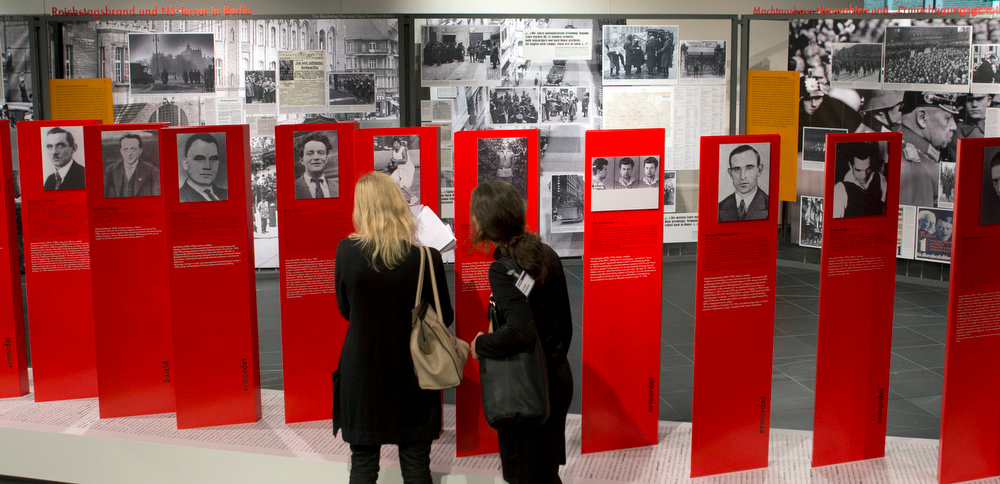 Description of . Two women look at exhibits of the 'Berlin 1933 - the way to despotism' exhibition at the Topography of Terror museum in Berlin, Germany, Wednesday, Jan. 30, 2013. The Topography of Terror museum is located at the area where the headquarters of the Gestapo and SS were destroyed by allied bombing. (AP Photo/Michael Sohn)