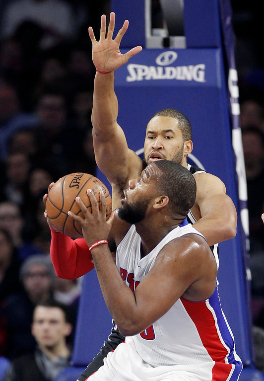 . Brookyn Nets\' Jerome Jordan, rear, defends Detroit Pistons\' Greg Monroe during the first half of an NBA basketball game Saturday, Nov. 1, 2014, in Auburn Hills, Mich. (AP Photo/Duane Burleson)