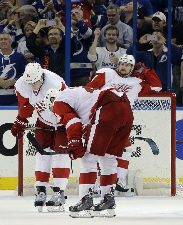 . Detroit Red Wings defenseman Brendan Smith (2), defenseman Danny DeKeyser (65) and left wing Tomas Tatar (21), of Slovakia, react after Tampa Bay Lightning defenseman Anton Stralman, of Sweden, scored a goal during the third period of Game 7 of a first-round NHL Stanley Cup hockey playoff series Wednesday, April 29, 2015, in Tampa, Fla. The Lightning won the game 2-0. (AP Photo/Chris O\'Meara)
