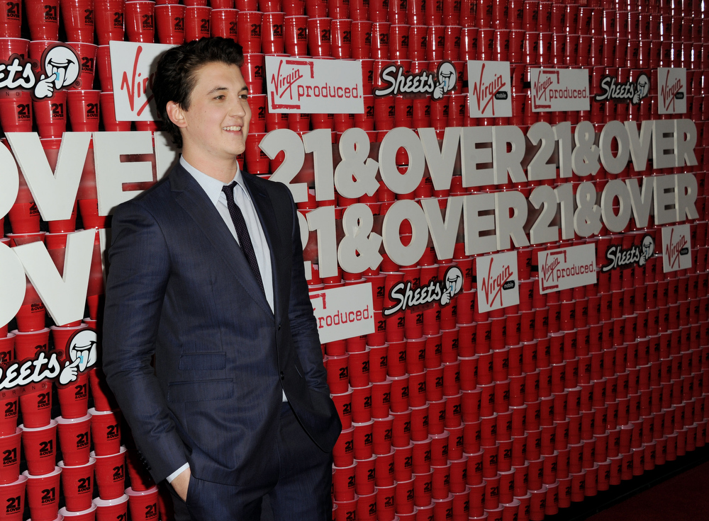 ". Actor Miles Teller arrives at the premiere of Relativity Media\'s ""21 And Over\"" at the Village Theatre on February 21, 2013 in Los Angeles, California.  (Photo by Kevin Winter/Getty Images)"