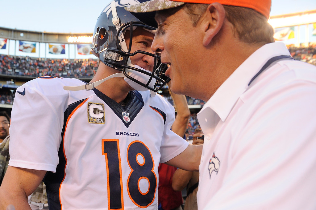 . Quarterback Peyton Manning #18 of the Denver Broncos and interim head coach Jack Del Rio after winning against the San Diego Chargers 28-20 at Qualcomm Stadium November 10, 2013 San Diego, CA. (Photo By Joe Amon/The Denver Post)