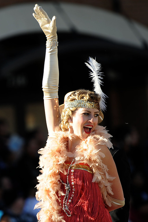 . Flapper dancers perform with Wells Fargo\'s entry during the 2014 Rose Parade in Pasadena, CA January 1, 2014.(Andy Holzman/Los Angeles Daily News)