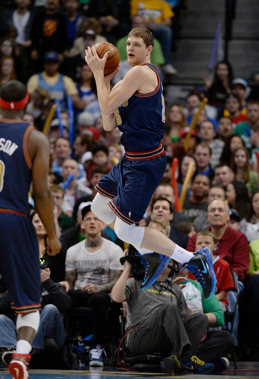 . Denver Nuggets center Timofey Mozgov (25) saves the ball from going out of bounds during the first quarter. (Photo by John Leyba/The Denver Post)
