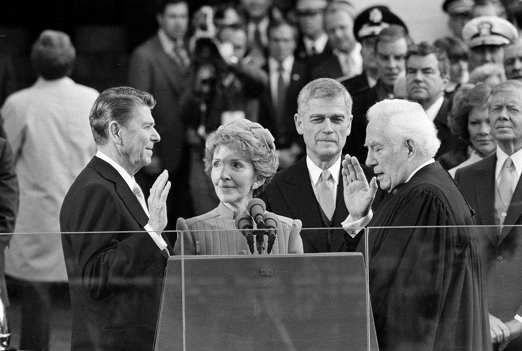 . President Ronald Reagan takes the oath of office as First Lady Nancy Reagan looks on in 1981 in Washington, DC. (AP Photo)