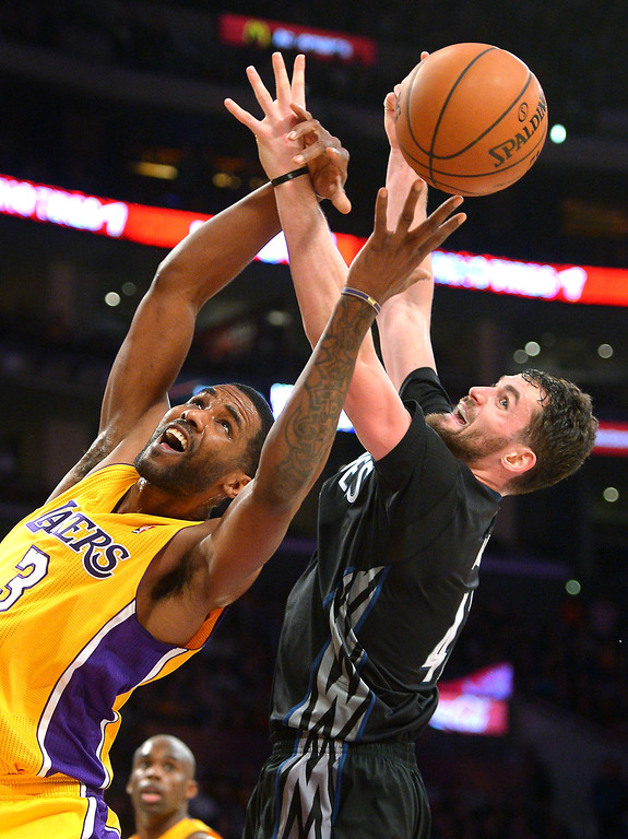 . The Lakers\' Shawne Williams and Timberwolves\' Kevin Love go for a rebound, Friday, December 20, 2013, at Staples Center. (Photo by Michael Owen Baker/L.A. Daily News)