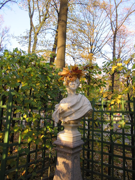 Bust of a woman in a garden