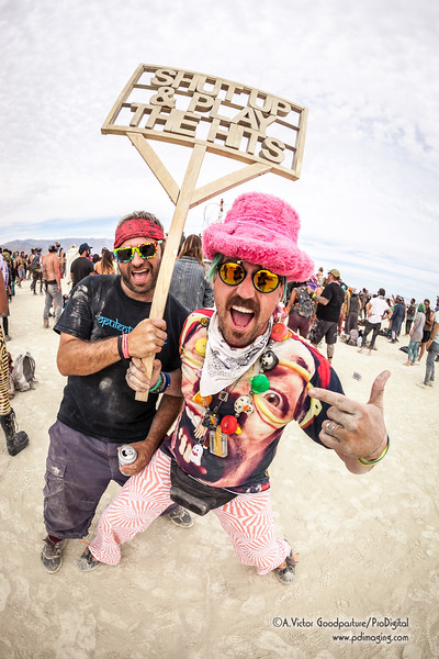 Everyone is having a great time,  many wearing colorfully unique outfits.